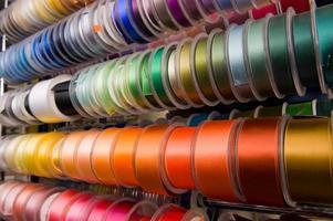 Multi-coloured ribbons on bobbins
