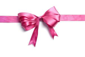 A pink, silk ribbon on a white background