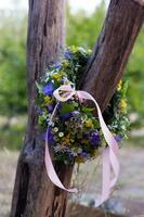 Handmade garlands hanging on a tree branch.