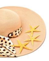 Woman beach hat and a seashell photo