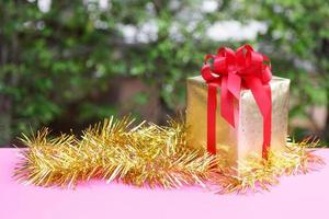 Christmas gift box  in nature background photo