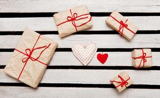 Gift boxes on white wooden background