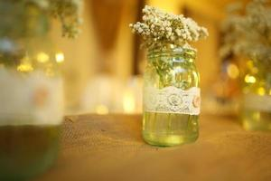 Flower arrangmnet, glass jar, at wedding,