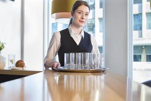 Happy waitress at work photo