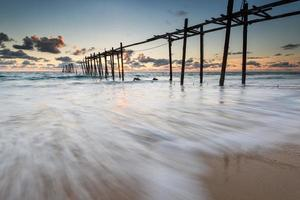 sea waves lash line impact on the sand beach photo
