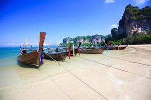 Tropical beach traditional long tail boat photo