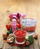 dried goji berries, water, nuts and fresh vegetables