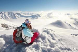 Hiker has fun in Caucasus winter mountains of Georgia