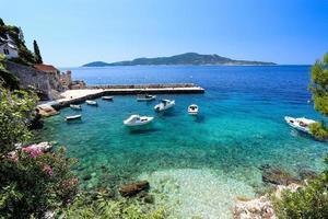 blue adriatric coast with boats photo