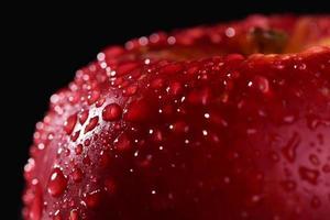 Red apple on dark background. Macro water drops