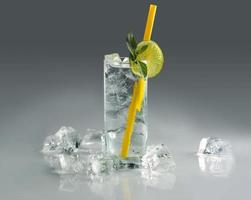 Glass of soda drink with ice photo