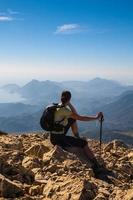 tourist woman on the top of mount, photo
