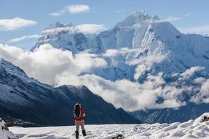 Hiker walks on train in Himalayas