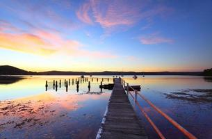 Colourful sunset and water reflections at Yattalunga Australia