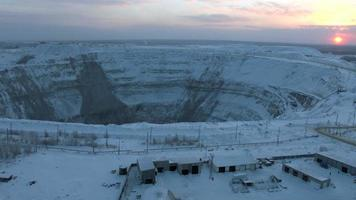 Aerial shot of big open mine pit at place of kimberlite pipe at north landscape video