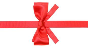 real red bow with square cut ends on silk ribbon photo
