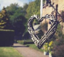 Heart of sticks hanging on white ribbon