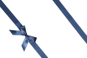 Blue ribbon with bow on white background photo