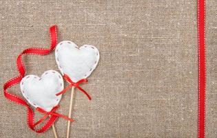 Valentine card with textile hearts and ribbon photo