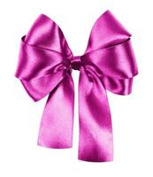 pink bow made from silk ribbon isolated photo