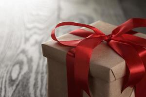 rustic gift box with red ribbon bow