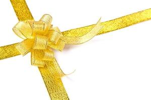 Gold ribbon with bow on white background