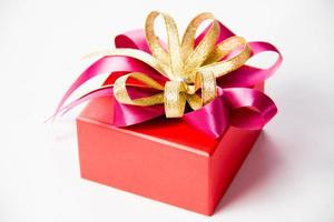 Gold gift box with  ribbon and bow
