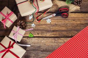 Christmas presents on a wooden background with candy