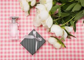 Gift box with a bouquet of peonies