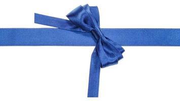 Turned real blue satin bow on narrow ribbon photo