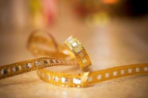 Bow. Golden satin gift bow. Ribbon. Christmas background