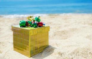 Gift box on the beach - holiday concept photo