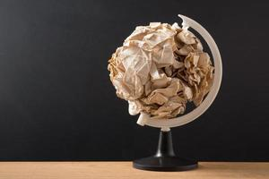 Crumpled paper ball globe