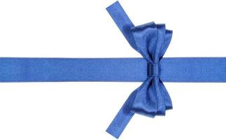 symmetric blue bow with square cut ends on ribbon photo