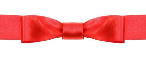 symmetric red bow knot on wide satin ribbon photo