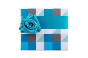 blue-gray gift box with ribbon tied like a rose