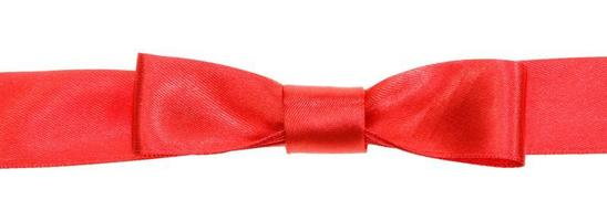real red bow knot on wide satin ribbon isolated photo