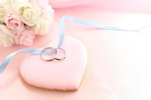 pair of wedding ring on icing heart shaped cookie