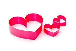 Red heart made from ribbon on white background