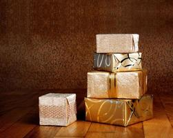 Gift box in gold wrapping paper with ribbon