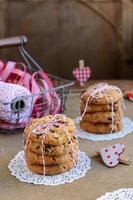 Cranberry cookies and basket with red-and-white ribbons, twine, heart pins