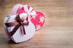 Heart shaped Valentines Day gift boxes on wood table.
