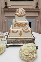 Bridal Bouquet and Wedding Cake photo