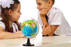 boy and girl with globe photo