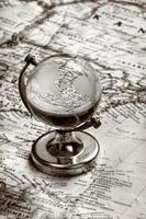 globe glass on old map photo