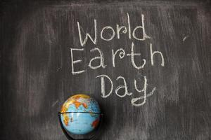 World Earth Day theme on blackboard photo