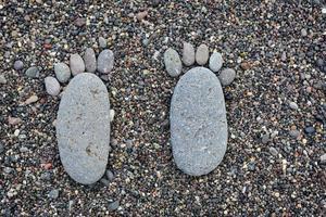 Footprint on wet sea pebbles