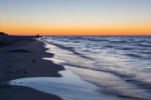 Baltic sea shore after sunset photo
