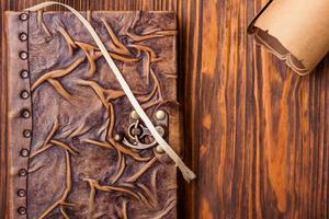 Old book and letter on wooden table photo