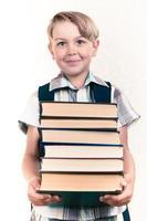 Boy carrying books photo